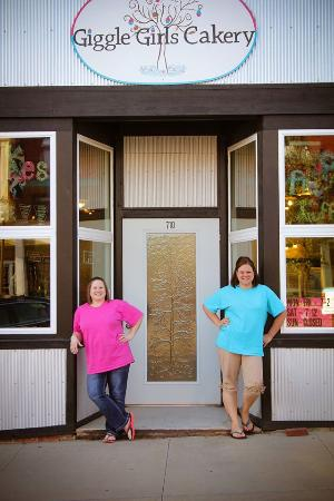 Hiawatha, KS: The Giggle Girls in front of their Store