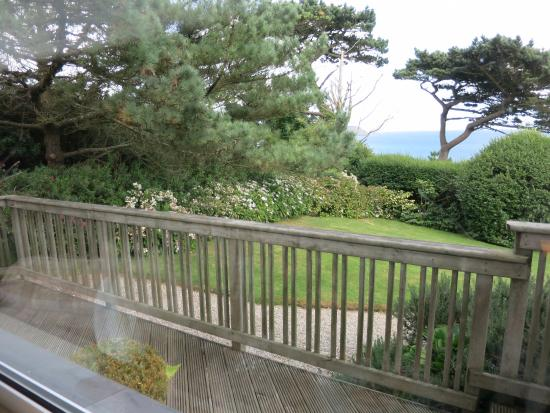 Trewithian, UK: A view of landscaping and distant sea