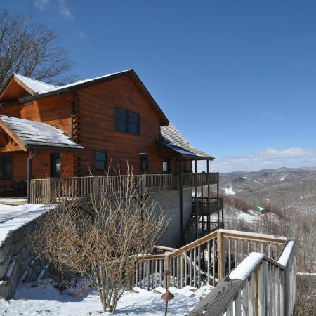 Scenic Wolf Mountain Cabins: A view of one of our cabins on a beautiful snowy day.