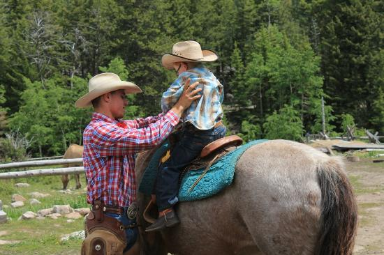 McLeod, MT: child mounts horse