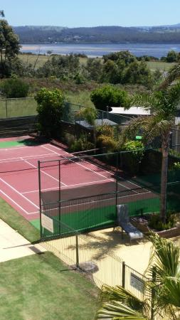 Apollo Luxury Apartments: Tennis court and view from back balconies