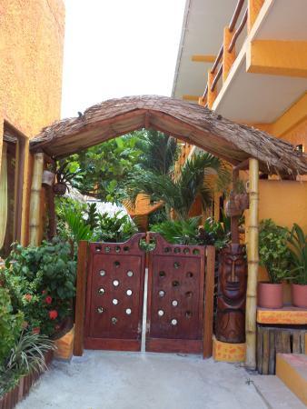 Seaside Cabanas: Ornate wood door entrance