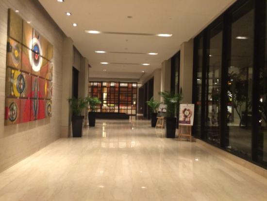 View of hotel entry and lobby picture of vivanta by taj for Motel exterior design