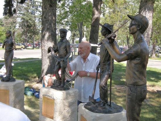 Walker, MN: Sculptor Joel Randell from Luther, OK with two of his `13 statues  called the Circle of Time in