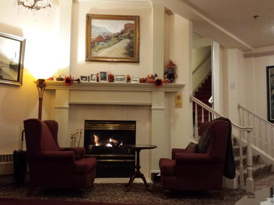 Historic Anchorage Hotel Cozy Fireplace Seating In Lobby