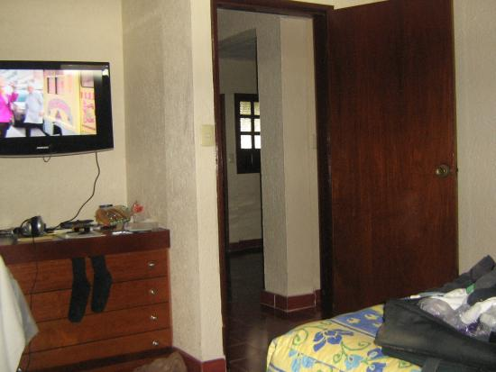 Suites Colonial: View from bedroom into living room & kitchenette