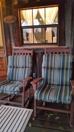 The Blue Heron Guest House: comfy porch sitiing