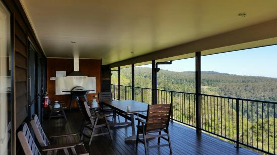 Bunya Mountains Accommodation: Large deck with table setting for 8 & Weber bbq