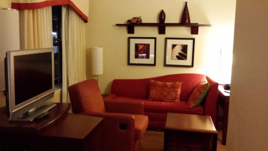 Residence Inn Birmingham Hoover: A hassock slips under small coffee table; TV stand doubles as dresser