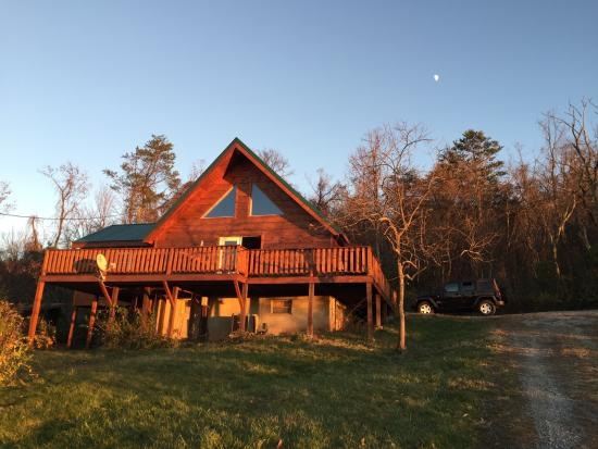 Rustic Cabins: Sunset View Chalet at the magic hour.