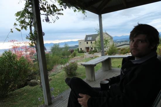 Fraser Highlands Retreat: having coffee in the morning on the porch