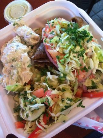 Zakia Deli: Gryo plate (to go) with tuna salad and Lebanese salad as the two sides.