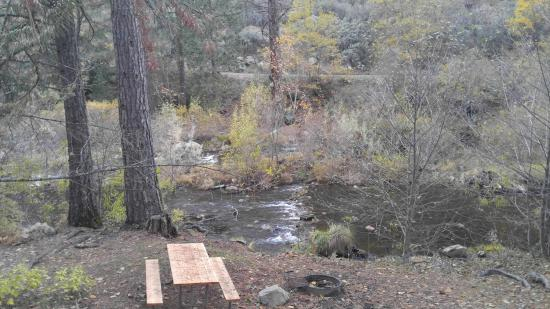 Yosemite Lakes RV Resort: Great river view from deck, picnic table and firepit