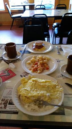 Marshall Diner: Village Scramble , two flaky biscuts, sausage graveyard and two screed eggs plus home fries.