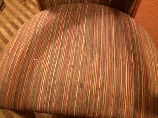 Orange, TX: Stains and burns on chair fabric
