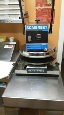 "Sunken Dorey Pizza: Our Somerset 18"" dough press preps a large 16"" dough in under 3 seconds!"