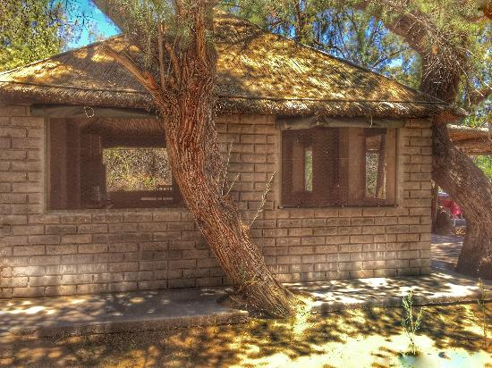Kalahari River & Safari Co: view of another river hut accommodation