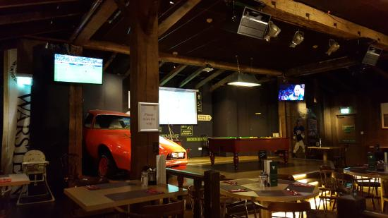Hayes, UK: View of the TV screens on one wall