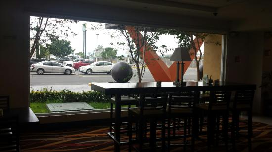 LQ Hotel by La Quinta San Luis Potosi: View of parking lot from breakfast dining area.