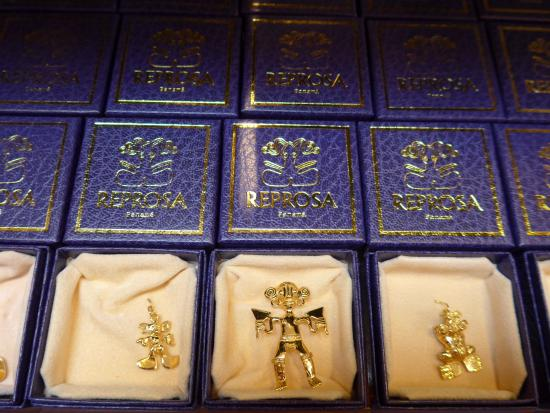 Treasures of Panama by Reprosa: Gold jewelry based on pre-Colombian designs in gift shop.