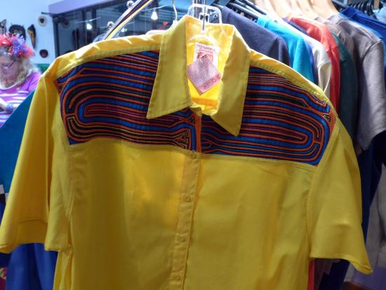 Treasures of Panama by Reprosa: Shirt with mola is example of other crafts in gift shop.