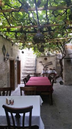 Old Greek House Restaurant and Hotel: Stairs to the outside rooms upstairs from dinining room