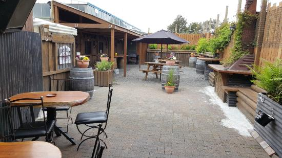 The John Roy: Dine in our private outdoor courtyard under the umbrellas