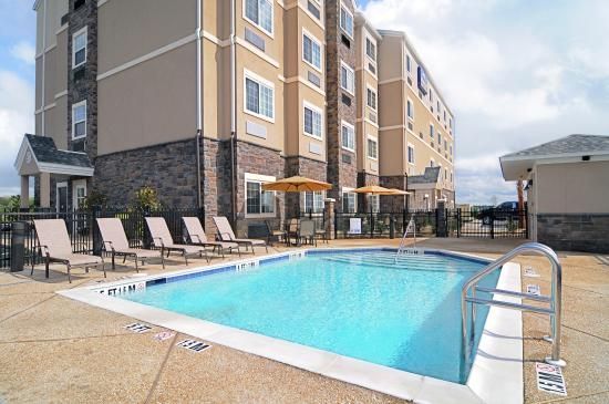 Microtel Inn & Suites by Wyndham Opelika: Outside Pool with patio seating area