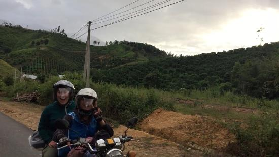 Easy Rider Club - Dalat Daily Tours: Ut flashes his big smile while we drove down the road.