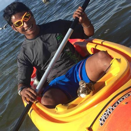 BK Adventures: Ramesh BK, Owner of BK Adventure with Bird on his kayak.