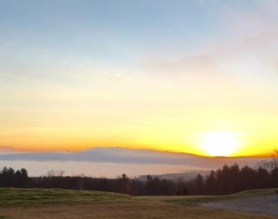 Sanbornton, NH: Sunrise over the fog shrouded lake/valley