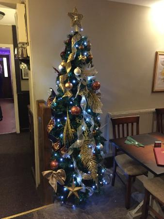 Childer Thornton, UK: Christmas tree all up! Call us to book your Christmas table.