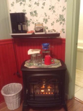 A White Jasmine Inn: Minature fireplace, coffee, cream & sugar, pitcher of filtered water