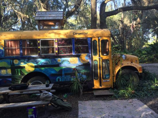 Canoe Outpost - Little Manatee River: Side bus area complete with mural, picnic table and fire pit.