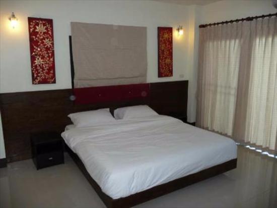 Спальная комната в номере отеля Crystal Clear Thailand
