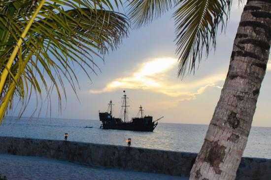 The pirate ship crosses over the sunset - early sunset