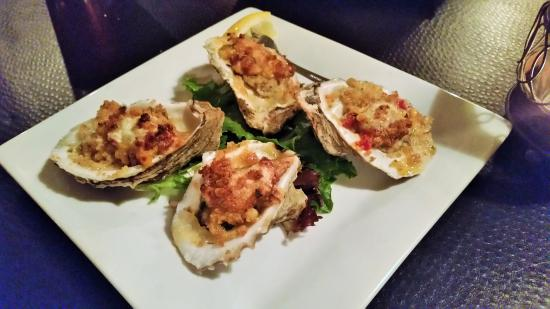 Chestertown, NY: Chorizo Oysters - broiled & topped w/ chorizo, corn & red pepper cream sauce, & blue cheese.