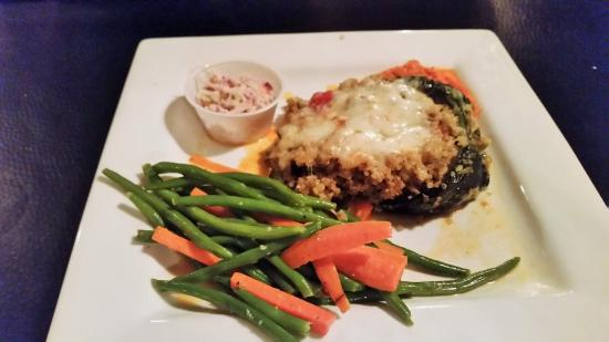 Chestertown, NY: Quinoa Stuffed Chile Rellenos with red piquillo pepper sauce and optional manchego.