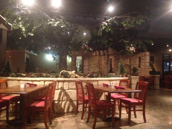 Backyard Bbq Restaurant restaurant with fake tree. good idea? or not? not sure. - picture of