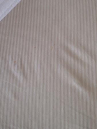 DoubleTree by Hilton Resort Zanzibar - Nungwi: Pictures upon arrival. Stain in the sheet, leaking a/c. Below Hilton standards