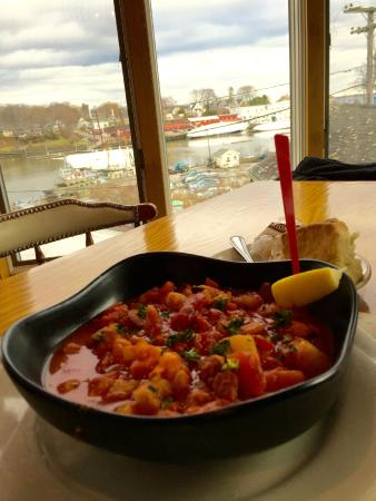 Cappy's Chowder House : Cape's seafood chowder with Camden Harbor in background