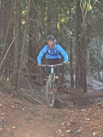 Big Swingin' Cycles - California Mountain Bike Tours: Alex mid-air on Braille (yes there's B line!)
