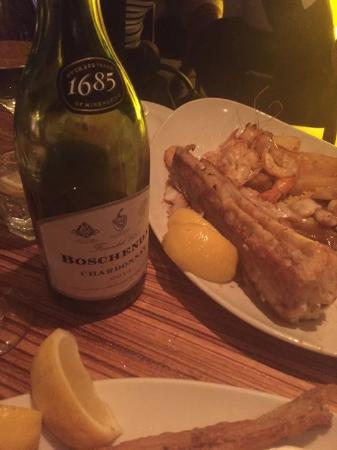 Lemon Butta Hermanus: Seefoodplatter with kingklip, calamaris and scampi. And of course a nice bottle of chardonnay