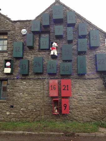 Priddy, UK: Advent Calendar on outside wall