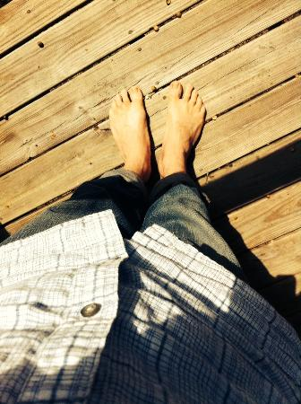 Cajun Country Cottages Bed and Breakfast: Warm weather, wood decks = bare feet.