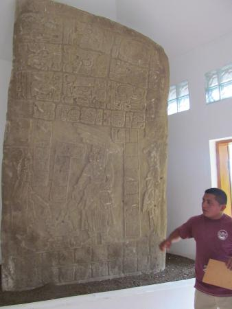 Punta Gorda, Belize: guide interpreting stelae at Nim Li Punit Mayan ruin