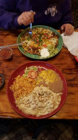 Carlitos': Pollo ala crema with rice and beans, and pizza Mexicana plate.