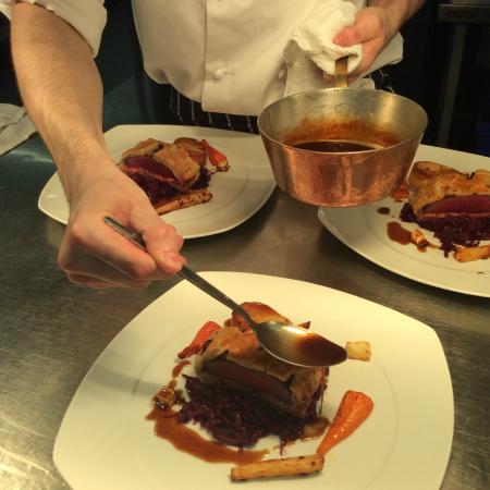 South Downs College Restaurant: Baked loin of venison 'Wellington with roasted roots, braised red cabbage, Madeira sauce