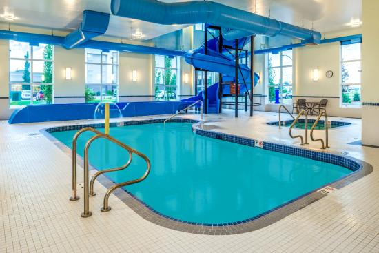 Indoor pool and hot tub with a slide  Indoor Pool, Hot Tub and Slide! - Picture of Microtel Inn & Suites ...