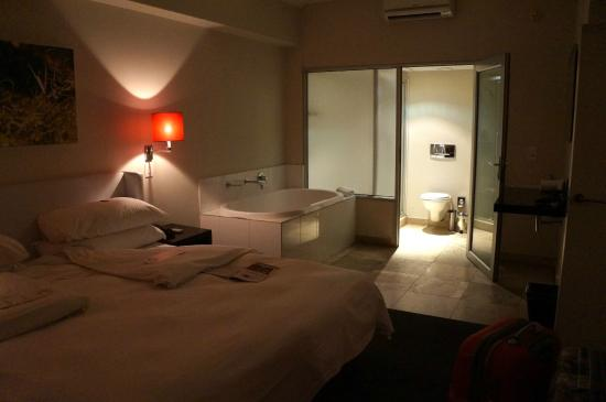 The spacious bedroom with romantic bathtub next to the bed - Picture ...